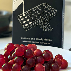 Red cherry infused edible gummies made with LEVO Gummy & Candy silicone molds.