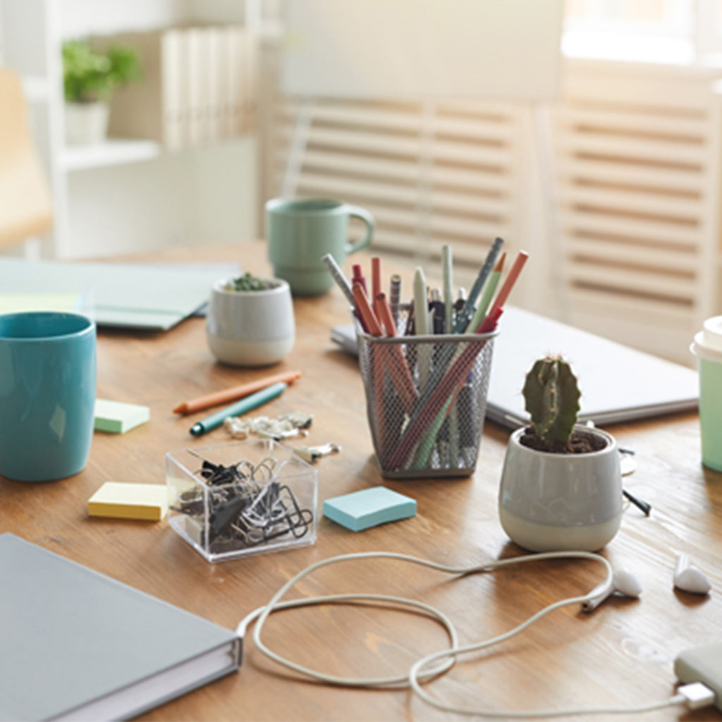 cluttered desk at home office