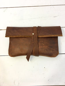 Brown leather wrap clutch