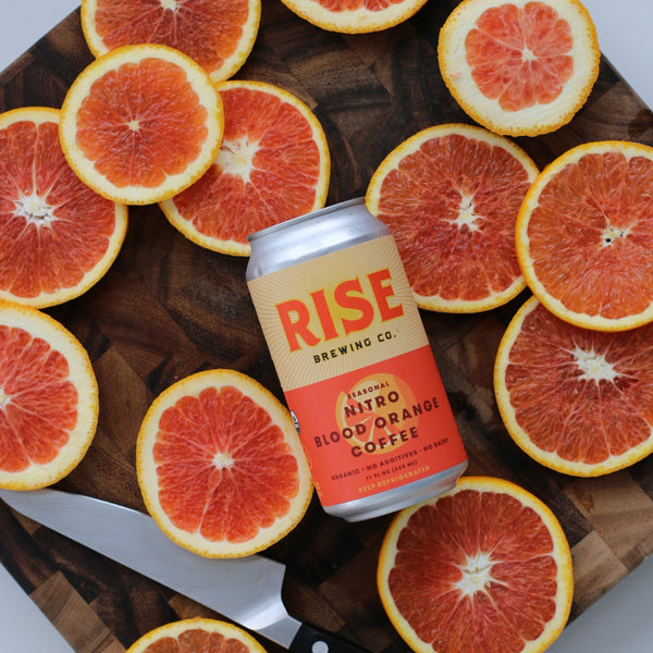 RISE nitro cold brew coffee in a can in the blood orange flavor to fuel workouts and exercise
