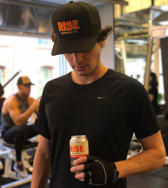 Man fueling his body with RISE Coffee in hand before starting workout | RISE Brewing Co.