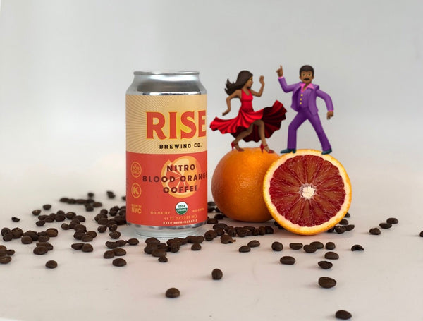 RISE Blood Orange Nitro Cold Brew Coffee in a can with coffee beans and dancing emojis