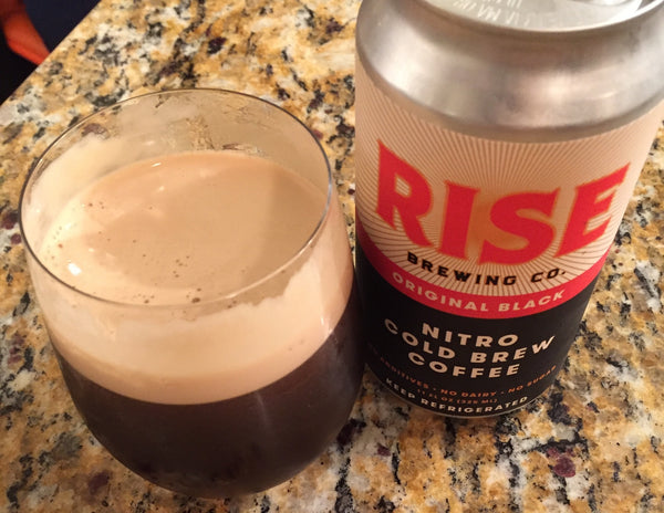 RISE Brewing Co. organic, non-GMO nitro cold brew coffee Original Black in a can and in a glass with creamy cascade