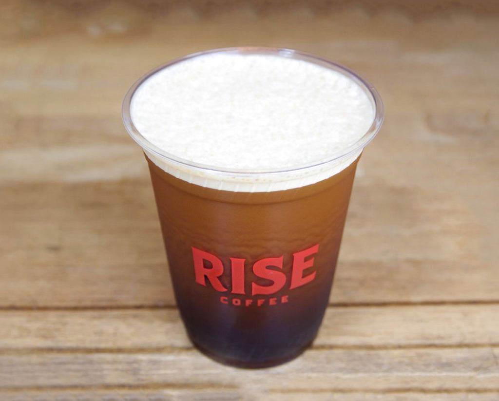 Cup of creamy, frothy, organic, and non-GMO RISE nitro cold brew coffee - RISE Brewing Co.