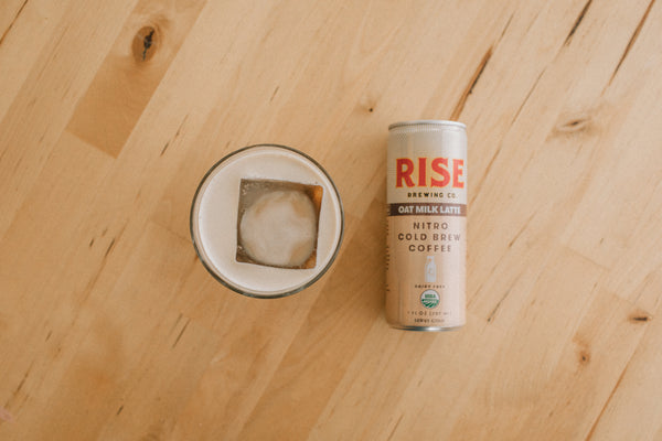 RISE Oat Milk Latte in a can and in a glass | RISE Nitro Brewing Co.