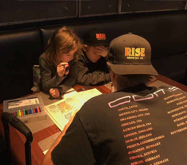 RISE Brewing Co. caps with father and kids