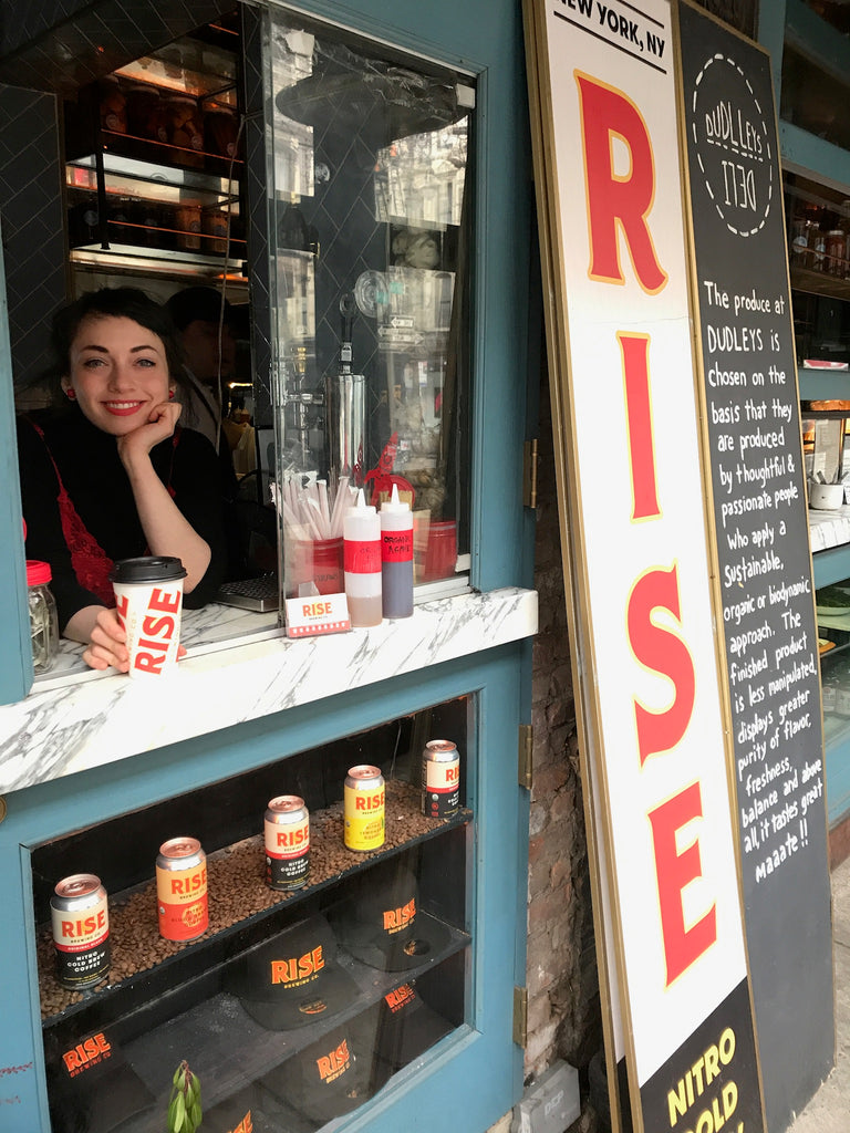 Barista at RISE cafe with nitro cold brew coffee in New York City - RISE Brewing Co.