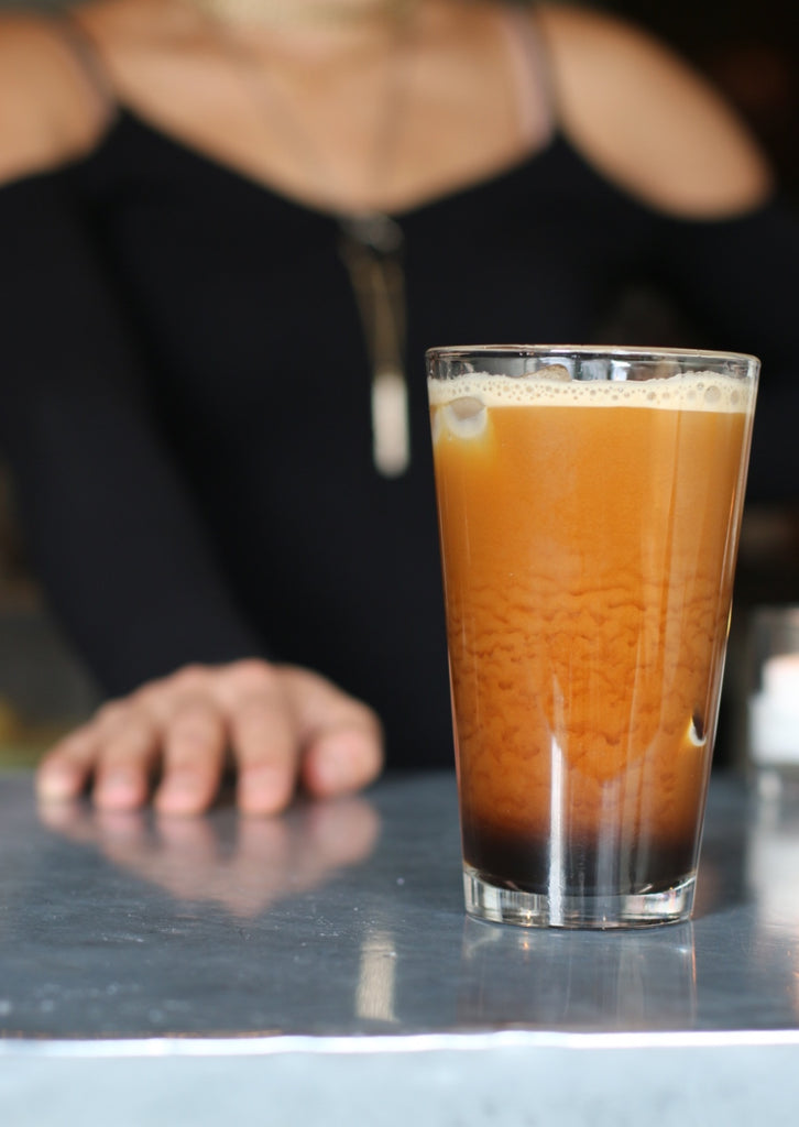 Glass of non-GMO, organic, non-dairy RISE nitro cold brew coffee - RISE Brewing Co.