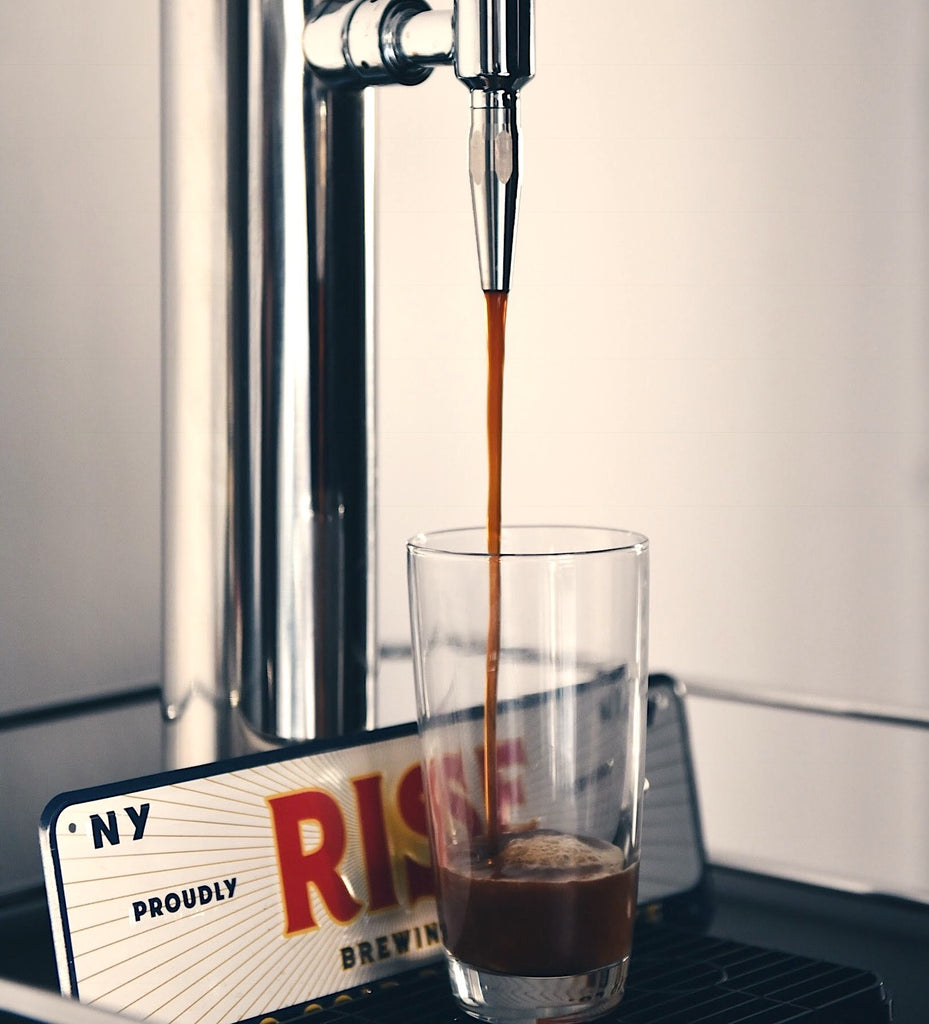 Tap pouring RISE nitro coffee into glass - RISE Brewing Co.