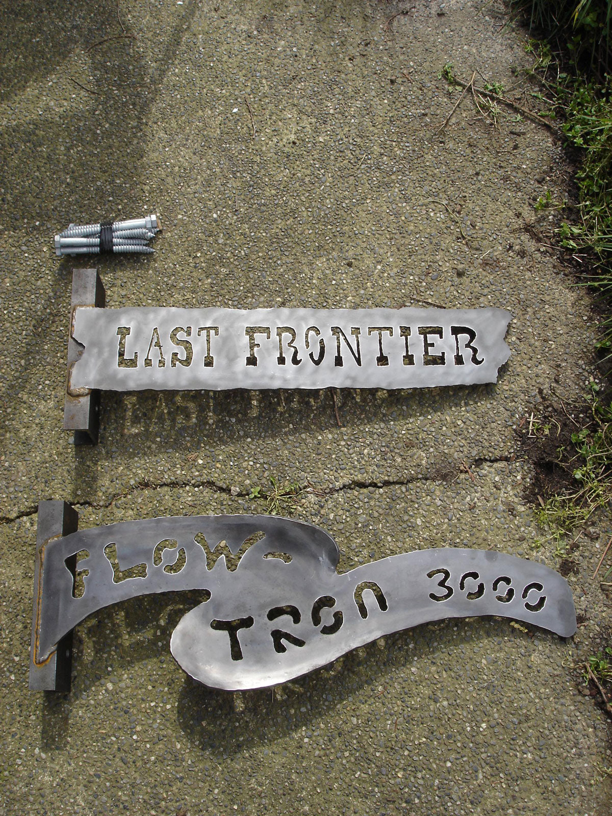 Last Frontier & Flowtron 3000 signs - Tokul