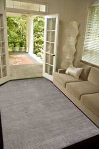 hand-loomed ash gray area rug art silk