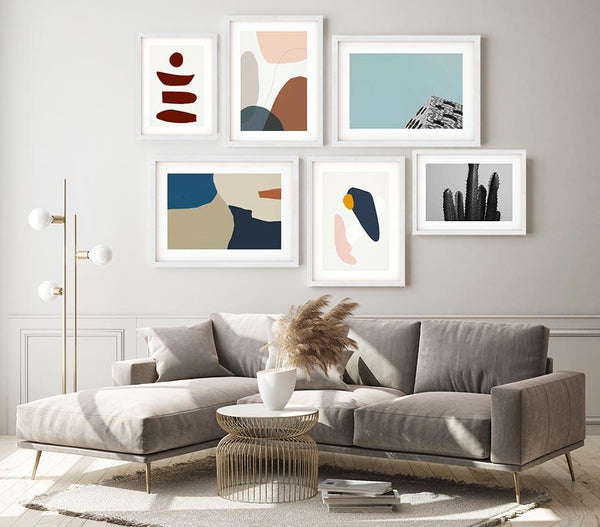 Abstract Art Prints with frames on a wall in living room