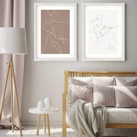 Set of two abstract line illustrations in neutral tones in a beige coloured living room
