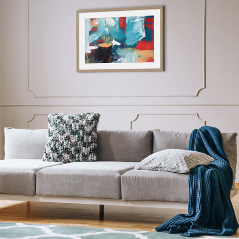 Framed abstract print on living room wall
