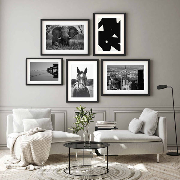 Monochrome art prints with frames on a wall