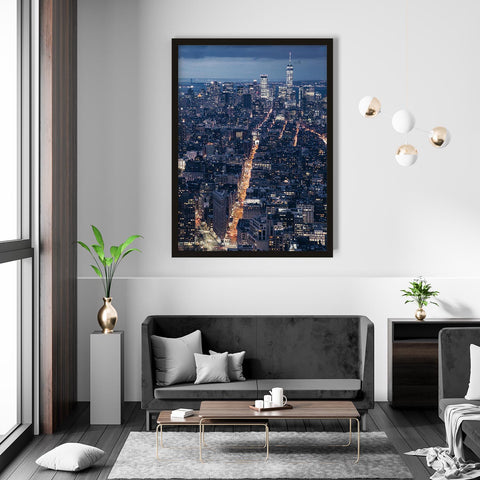 Framed photograph of New York City lights at night