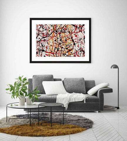 Framed abstract print of red and black paint splatters