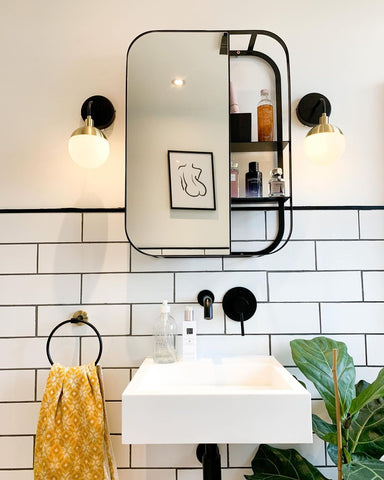 black and white bathroom square mirror shelf with mustard accents and monochrome line art of nude figure
