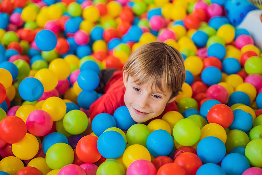 Child with ADHD playing in indoor playground during winter