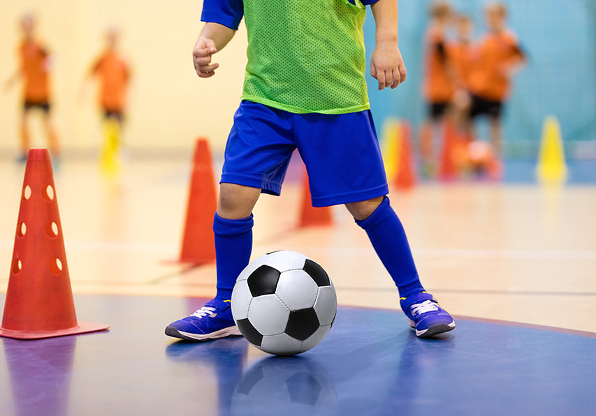 Child with ADHD playing indoor soccer