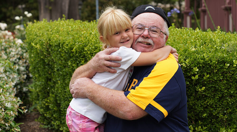 Girl hugging grandpa