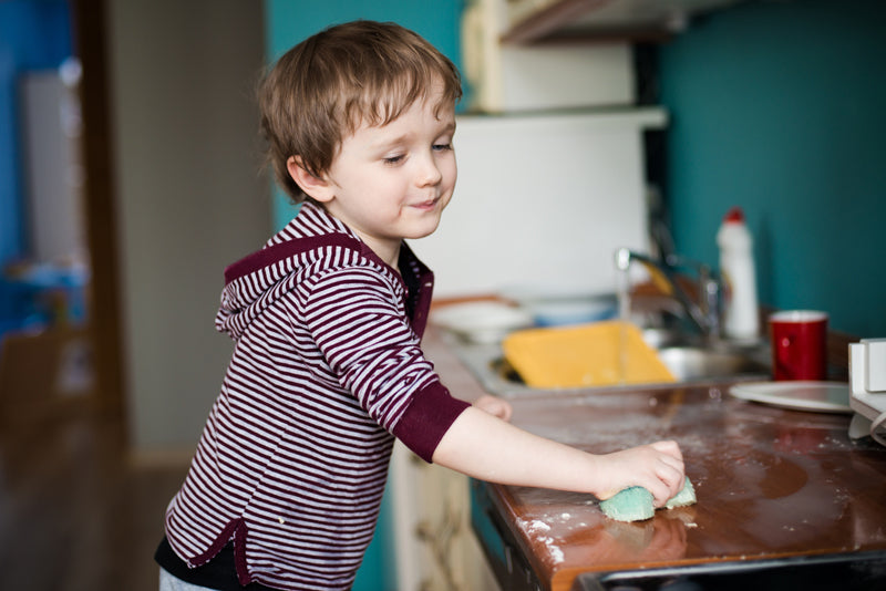 Child finishing cleaning routine