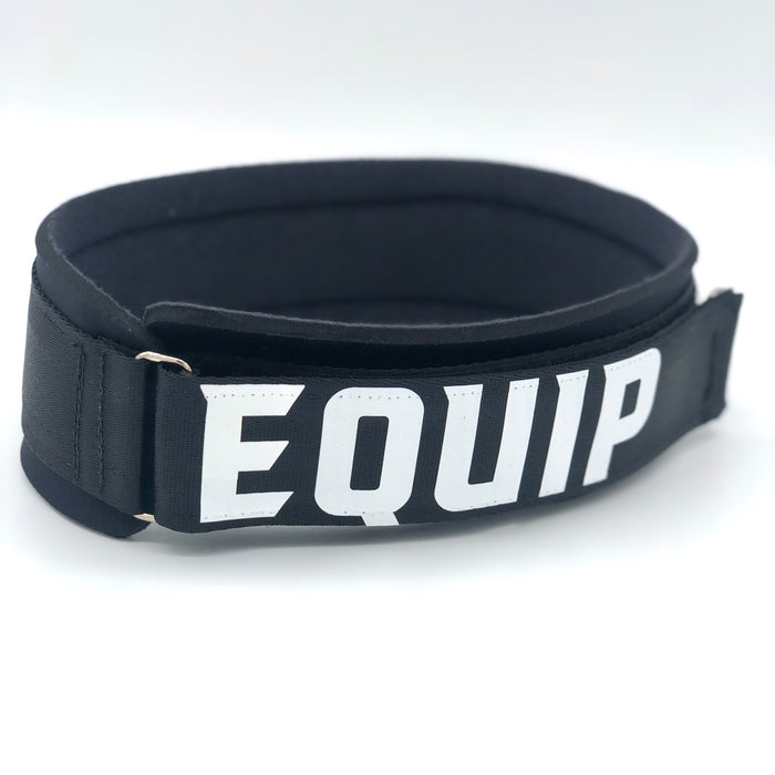 Angled slightly to the left Large Leg Strap black with white lettering that reads Equip, on a white background.