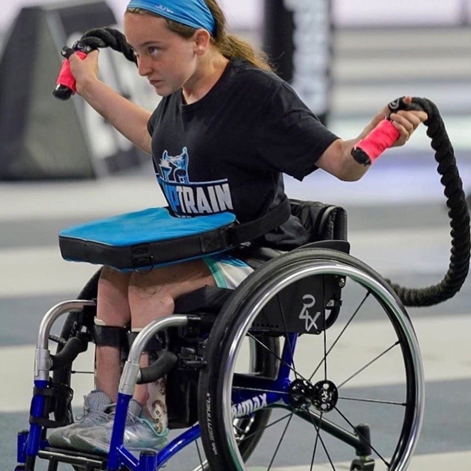 Wheelchair Athlete Josie Portel Using the Black Monster Rope sitting on her chair.