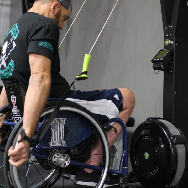 Athlete Chuck Melton using the Equip Ski Erg Extension straps on a Concept2 Ski Erg
