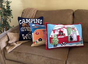 collection of three wool pillows with camping and trailer designs