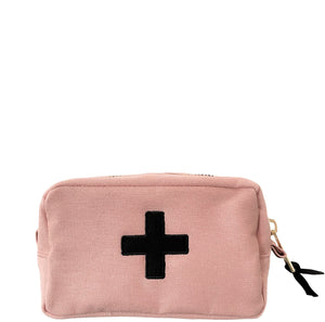 Pink medical case with black medical cross in the middle.