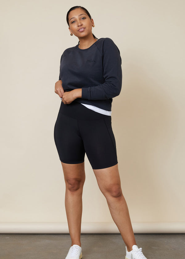High waisted black bike shorts with side leg phone pockets