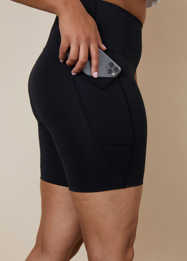 Sustainable High waisted black bike shorts with side leg phone pockets for large iphone