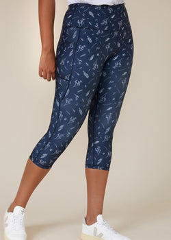Sustainable Australian Navy Blue 3/4 calf length leggings with side phone pockets with delicate floral botanical print in white