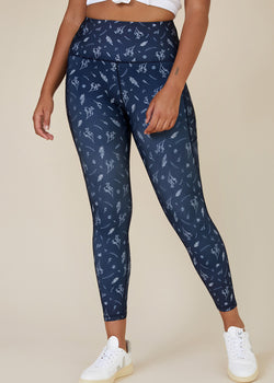 Sustainable Australian Navy Blue 7/8 ankle length leggings with side phone pockets with delicate floral botanical print in white