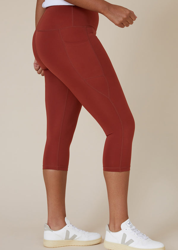 Sustainable Australian Burnt Orange 3/4 calf length leggings with large side phone pockets