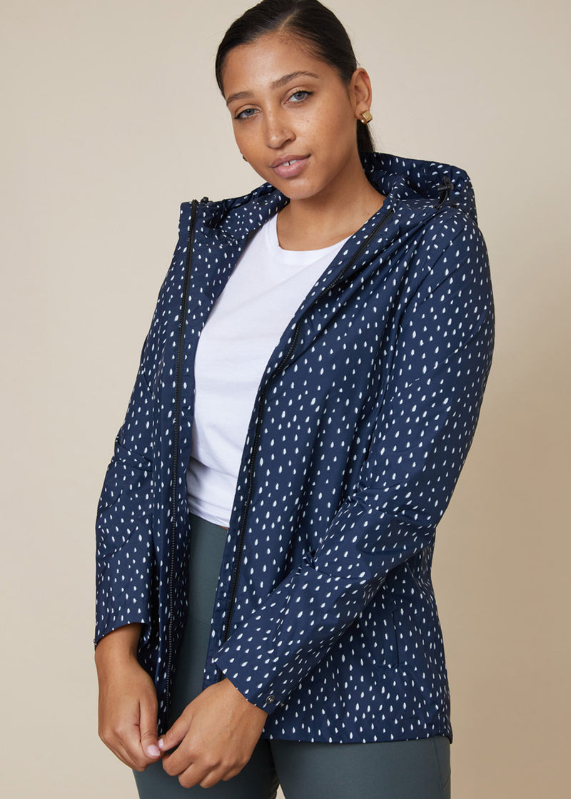 Sustainable waterproof raincoat with zip front, speckle navy and white pattern, dipped back and pockets