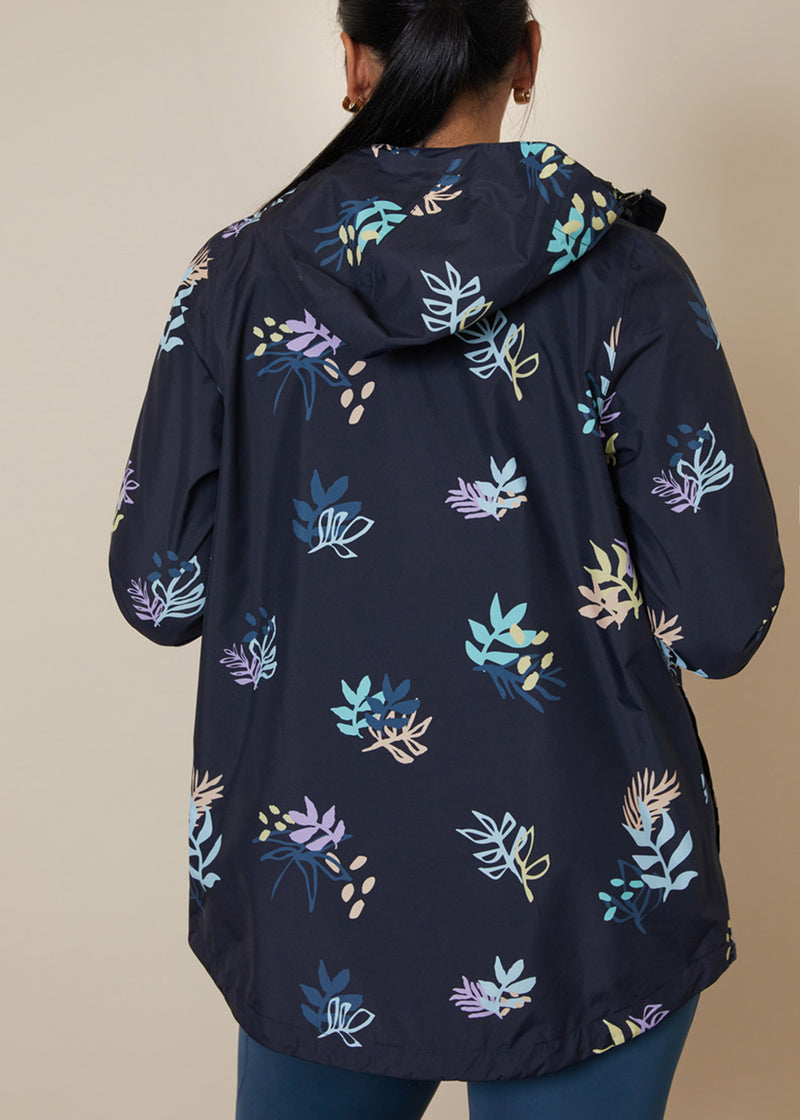 Sustainable waterproof raincoat, with floral pastel pattern, dipped back and hood