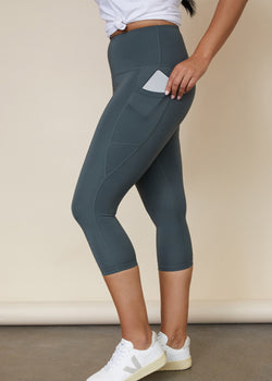 Side view of Gumnut green 3/4 length leggings with side pocket for phone