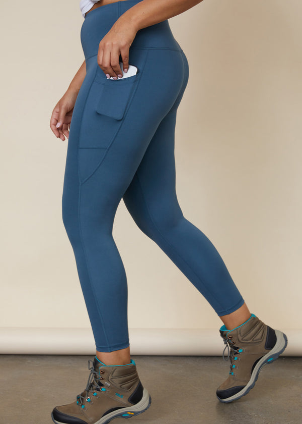 High waisted blue legging with wide waistband, side leg phone pocket, above ankle length
