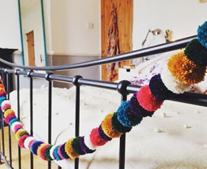 A pompom garland decoration to brighten any room. These pompoms were made 5 at a time and simply threaded onto a cord.