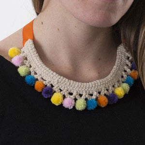 This necklace has been crocheted with a natural cotton. The mini pompoms certainly brighten it up!