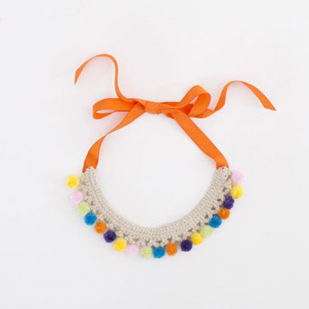 Gorgeous pompom crocheted necklace with colourful pompoms and ribbon bow.
