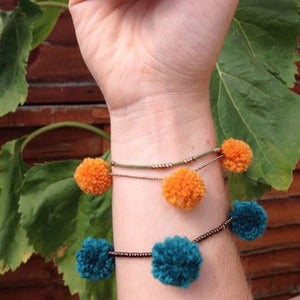Festival summer accessories! Pompom all your bracelets. The pompom ties make these so easy to make.