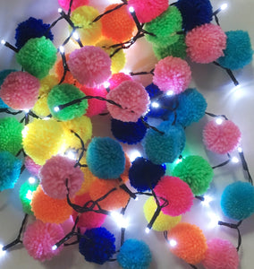 Brighten up your days by tying multicoloured pompoms to a string of fairy lights.