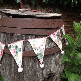 Hand picked pretty rosey fabric has been made into this gorgeous bunting. A simple mini pink pompom finishes off each triangle perfectly. We made 12 of these tiny pompoms at a time with Multipom.