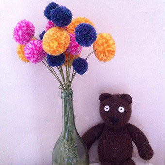 Mr Bean's Ted shows off his bunch of Multipom flowers. Make batches in various colours with your Multipom.