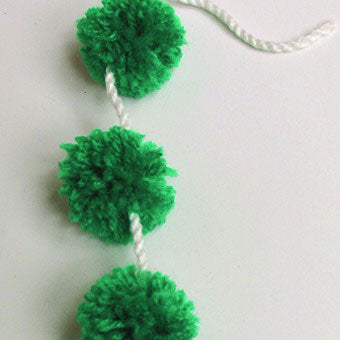 Simple and speedy. pompoms on a cord. Instructions to do so are included in all of our kits.
