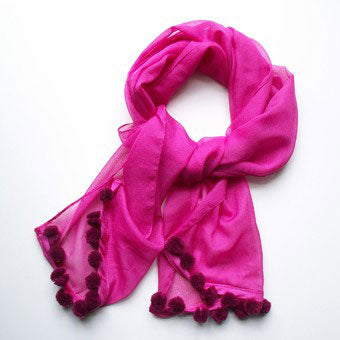 Pretty in pink. Make a plain pink scarf stand out with these mini handmade pompoms.