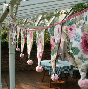 Decorate your outside space for a summer party with customised pompom bunting.